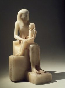 Statue of Pepi II who became pharaoh at age 6, and his mother, queen Ankhesenpepi II who served as regent. Courtesy of the Brooklyn Museum